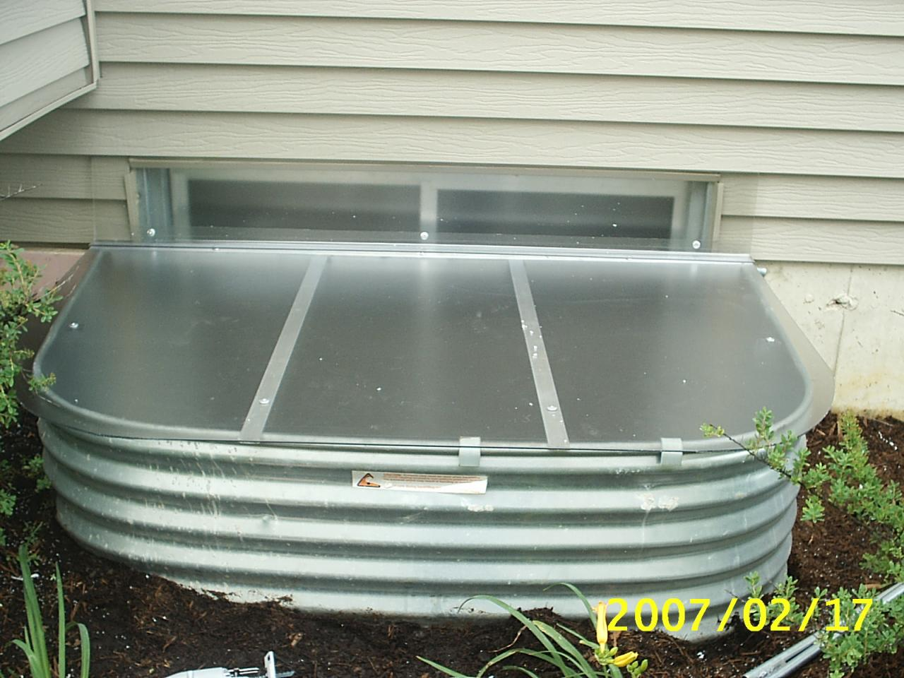 conquest steel window well cover how to clean